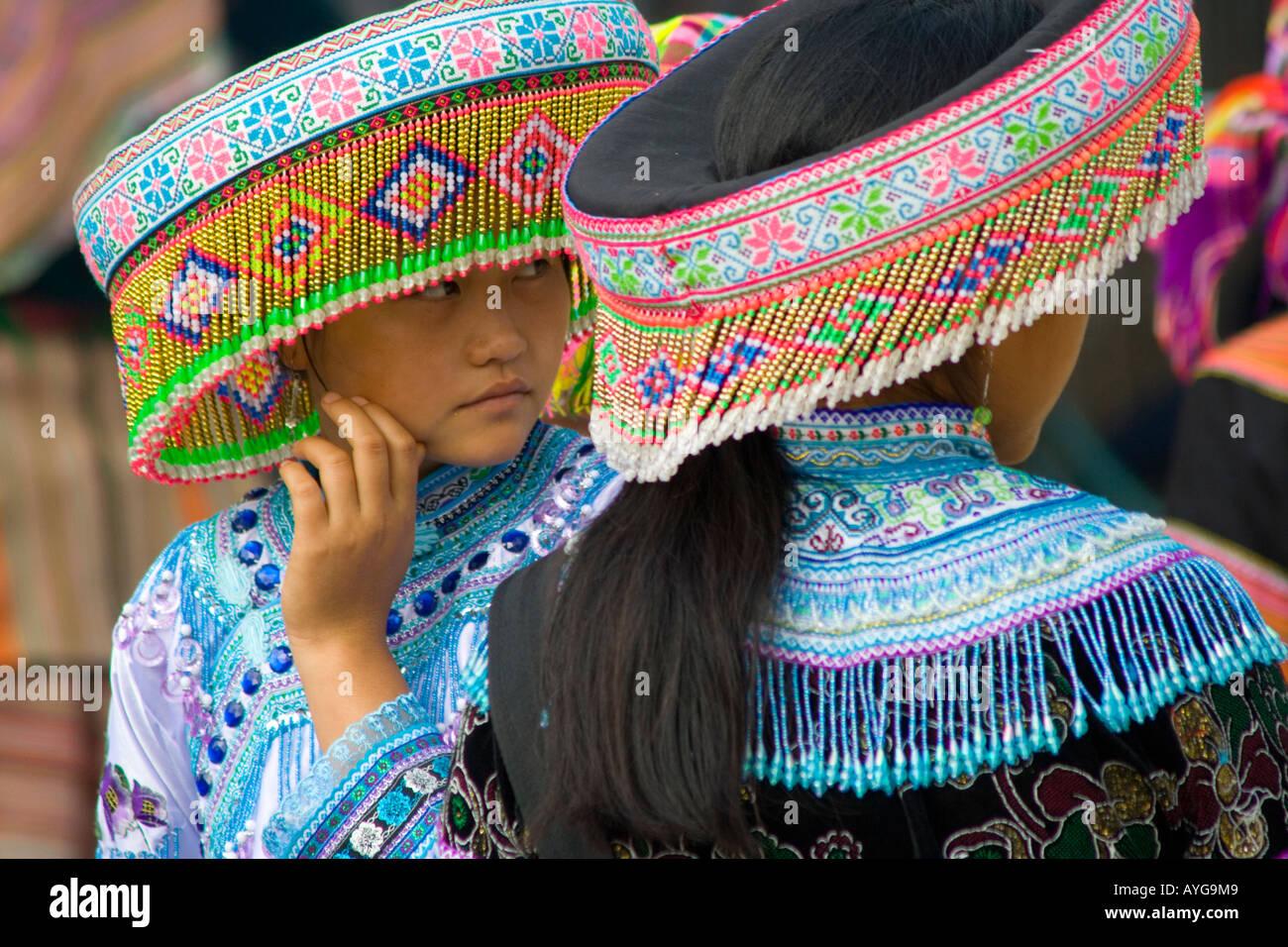Two Beautiful Young Flower Hmong Women Bac Ha Market near Sapa Vietnam Stock Photo