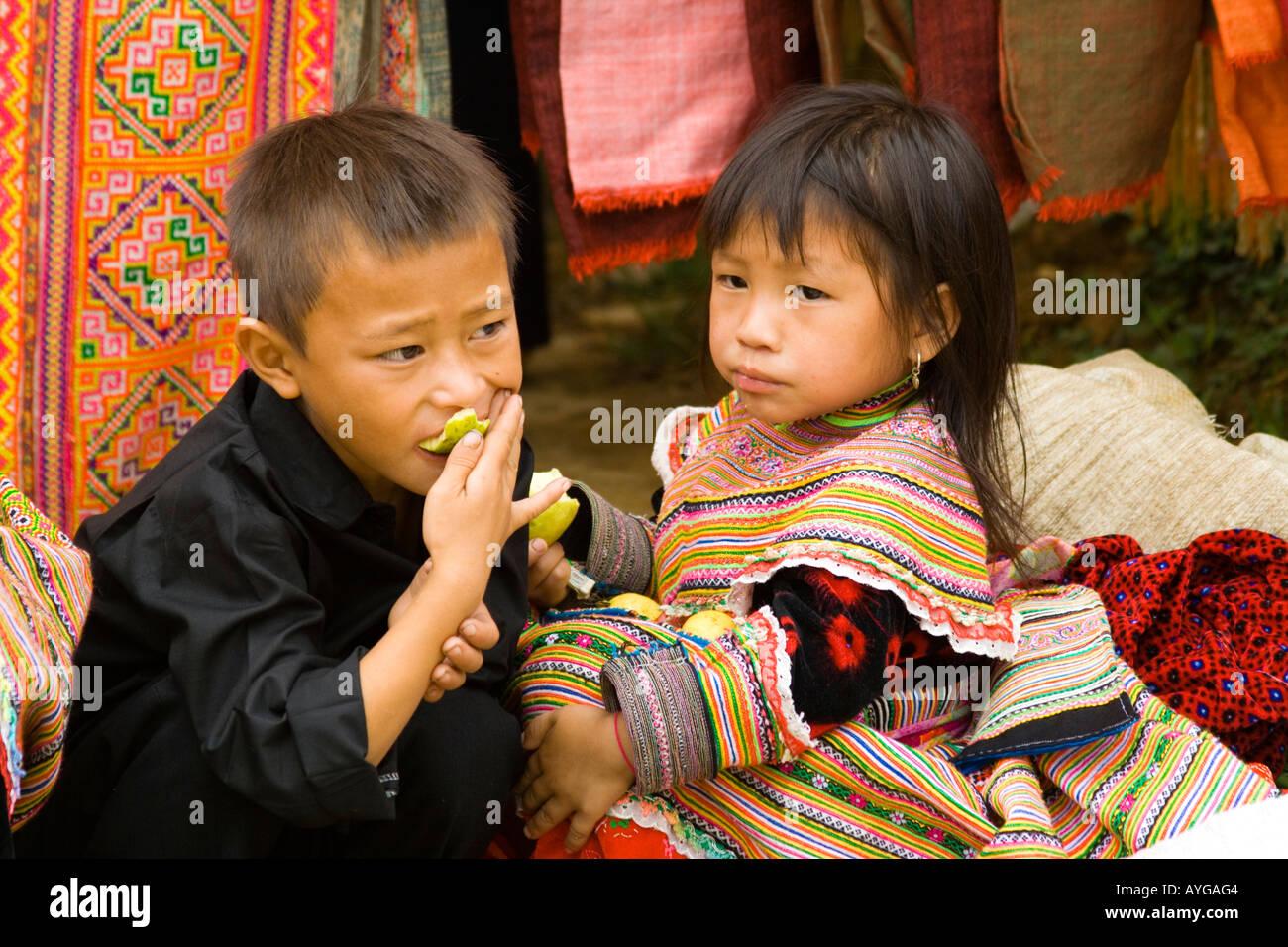 Flower Hmong Children Eating Fruit Bac Ha Market near Sapa Vietnam Stock Photo