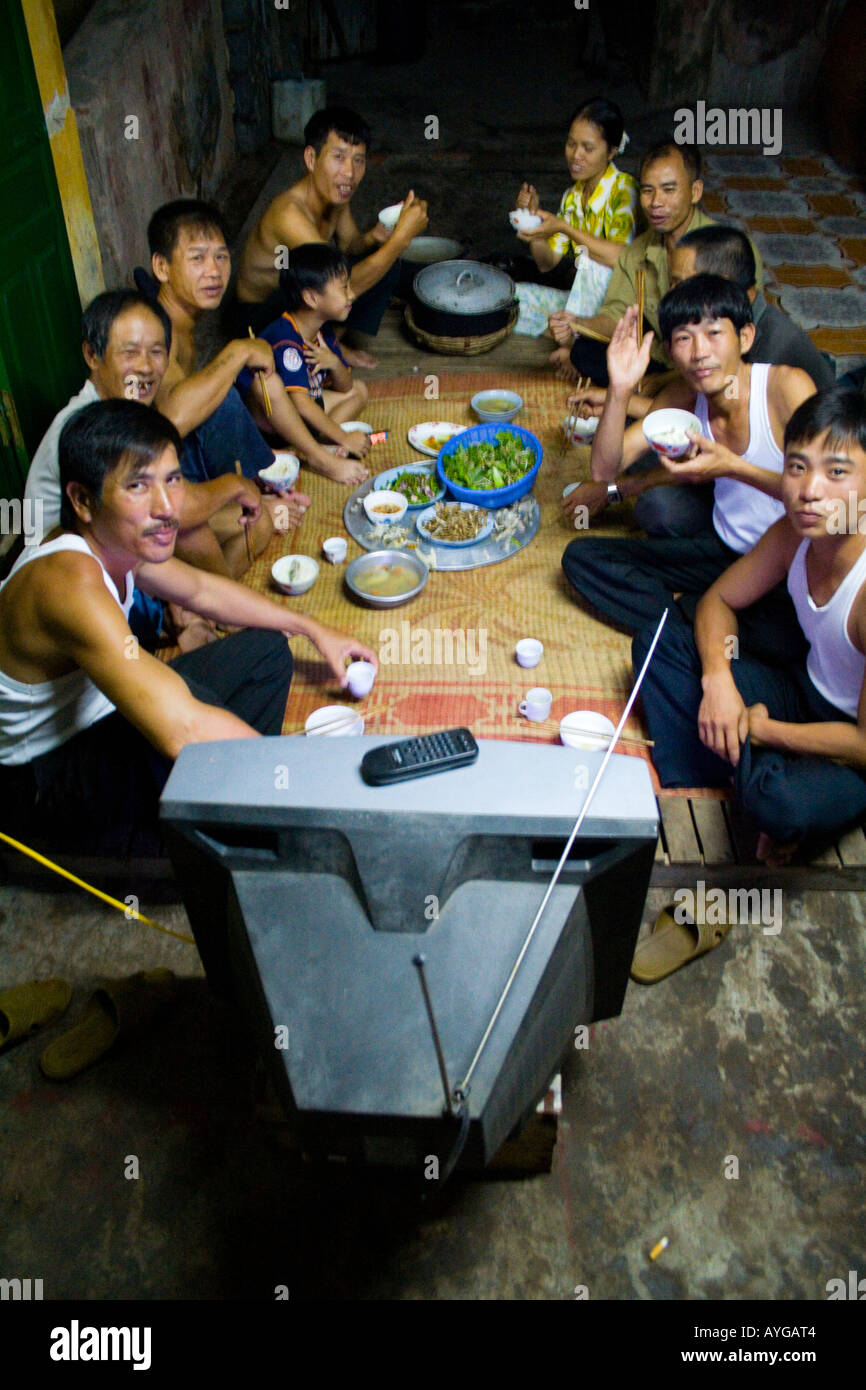 Meal Time Vietnamese Family Sitting Down to Eat Dinner Cat Ba Island Halong Bay Vietnam - Stock Image