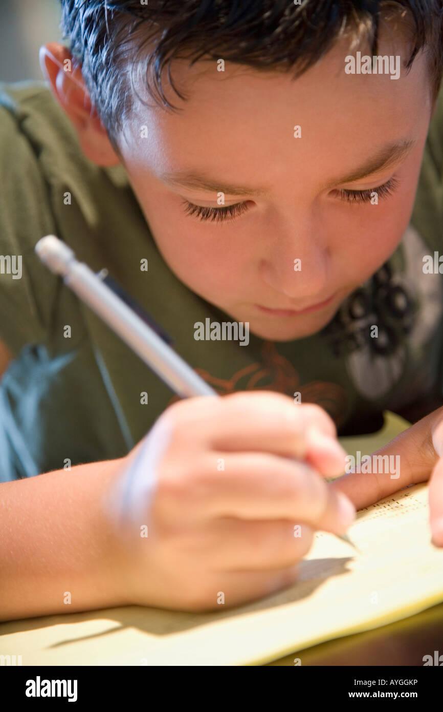 Boy writing - Stock Image