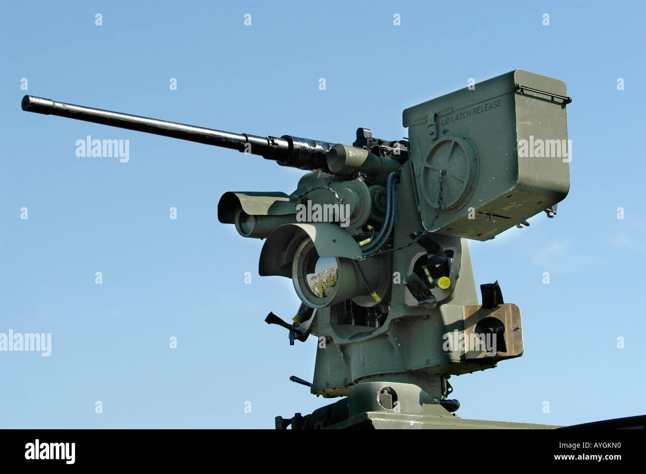 Machine gun mounted atop an Army tank - Stock Image