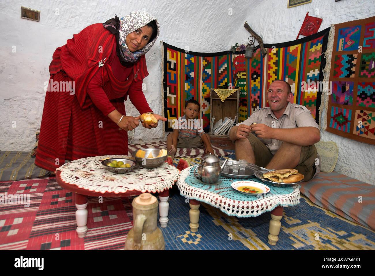 Woman entertains visitor in her underground Berber troglodyte home Matmata Tunisia Stock Photo