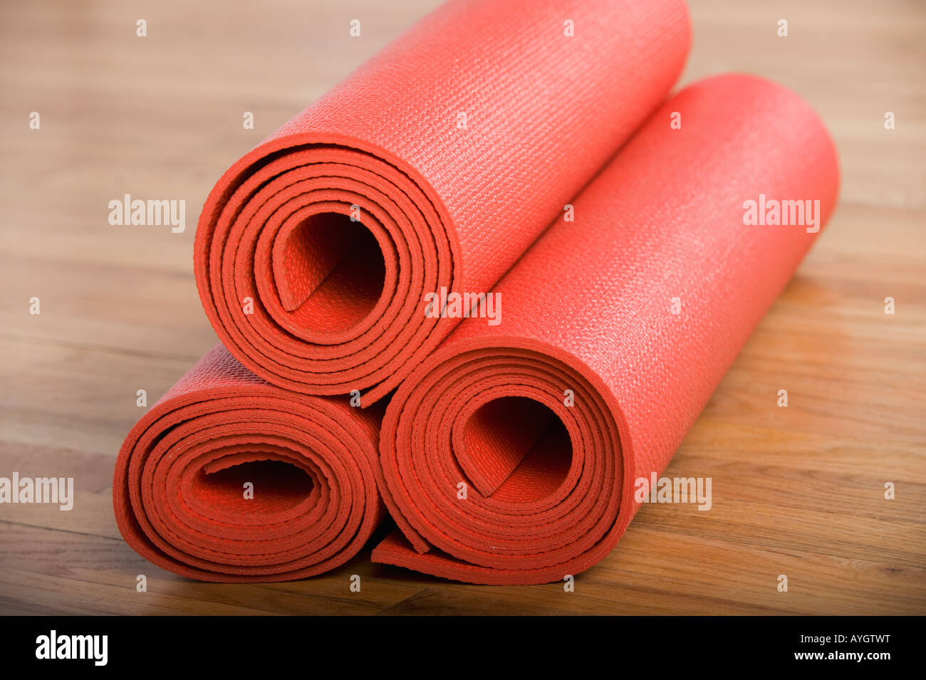 Stack of rolled yoga mats - Stock Image