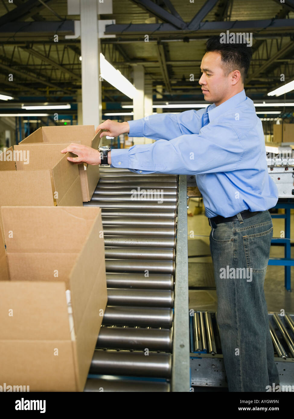 Asian male factory worker checking product Stock Photo