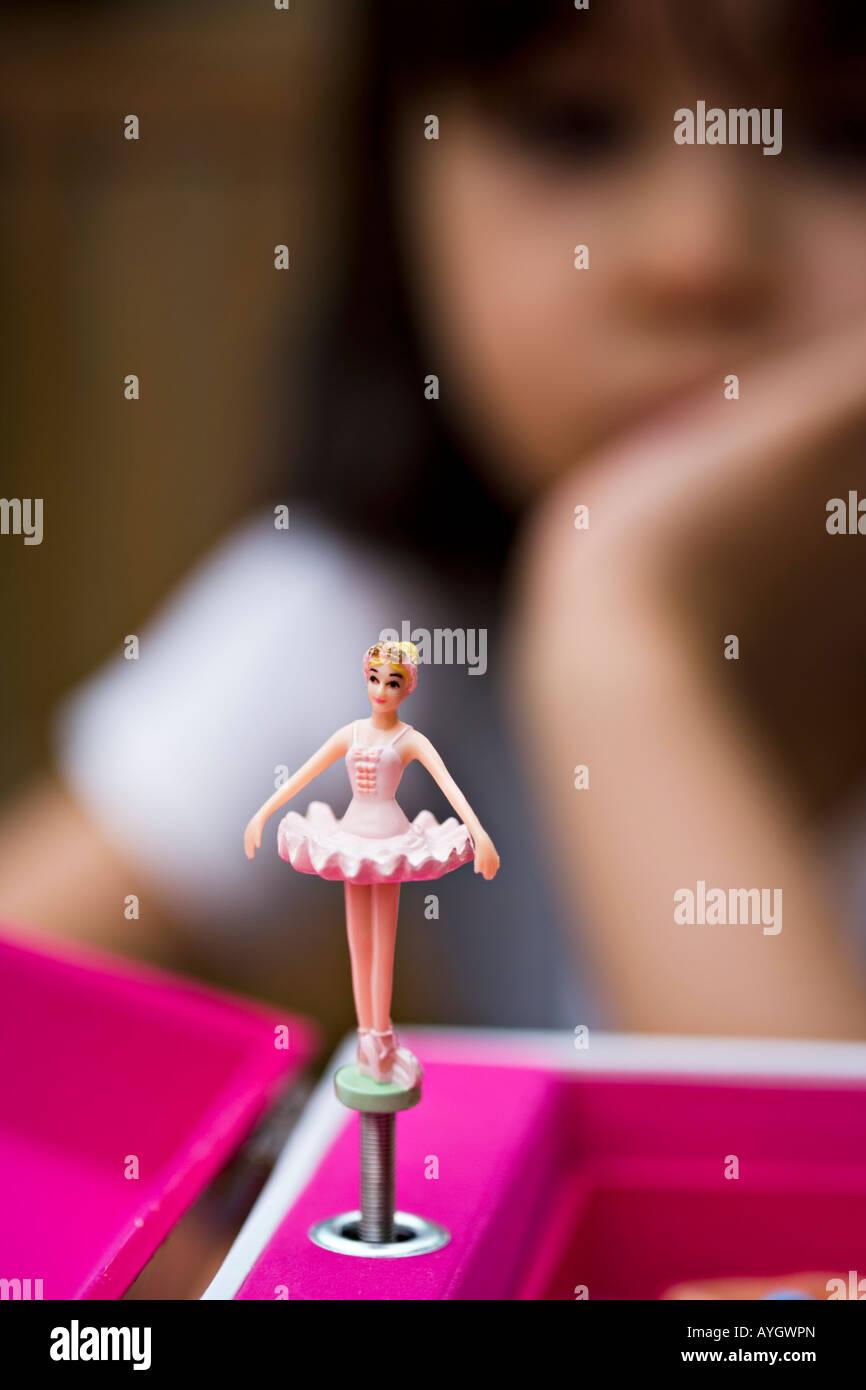 Little girl watches music box ballerina - Stock Image