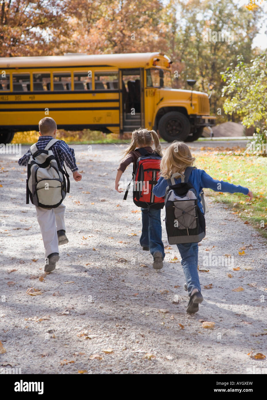 Children running towards school bus - Stock Image