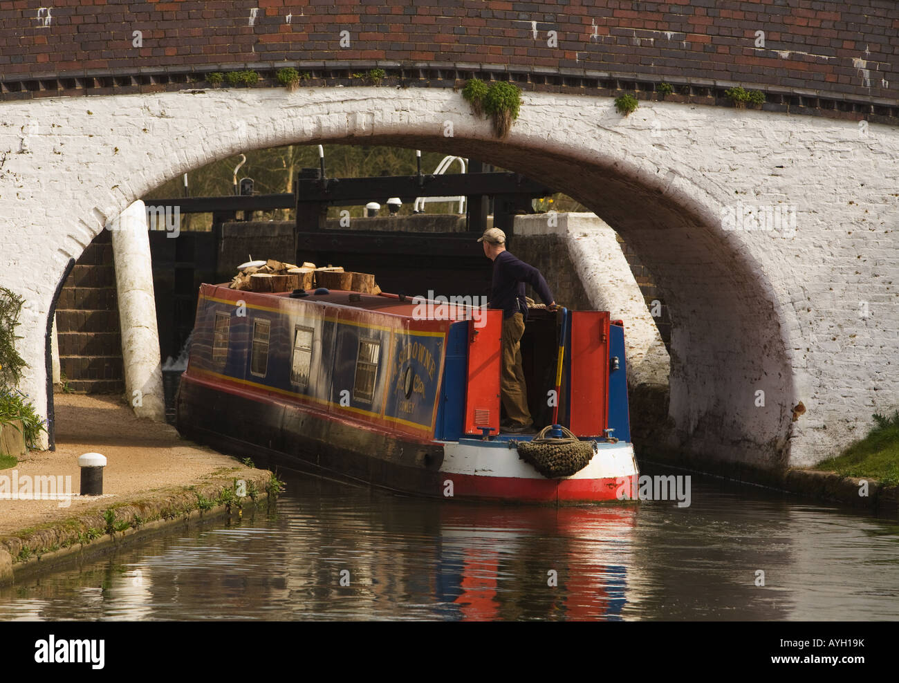 Narrow Boat underneath a Canal Bridge at Stockers Lock on the Grand Union Canal near Rickmansworth, Herts. - Stock Image