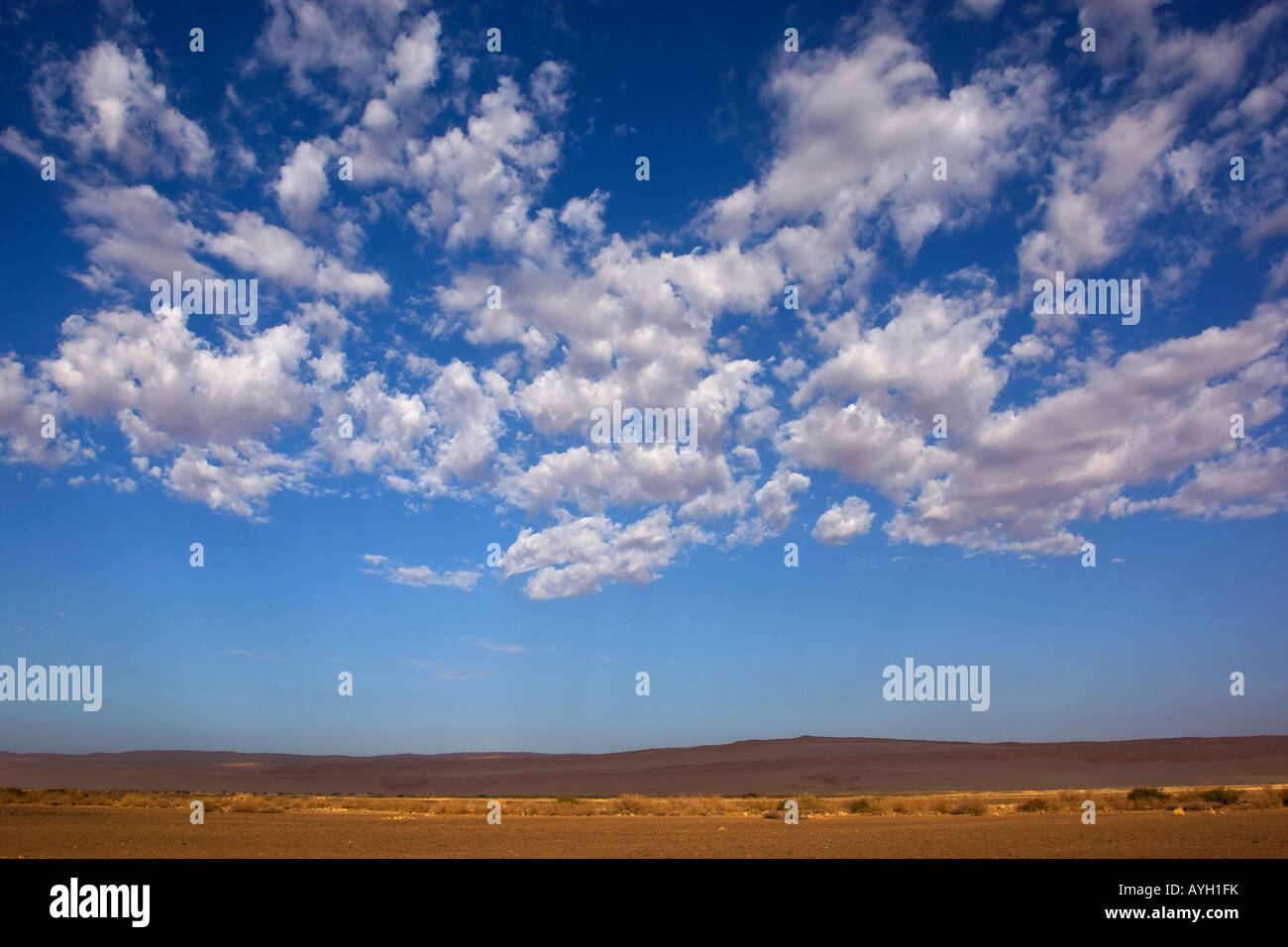 Clouds in blue sky, Namib Desert, Namibia, Africa - Stock Image