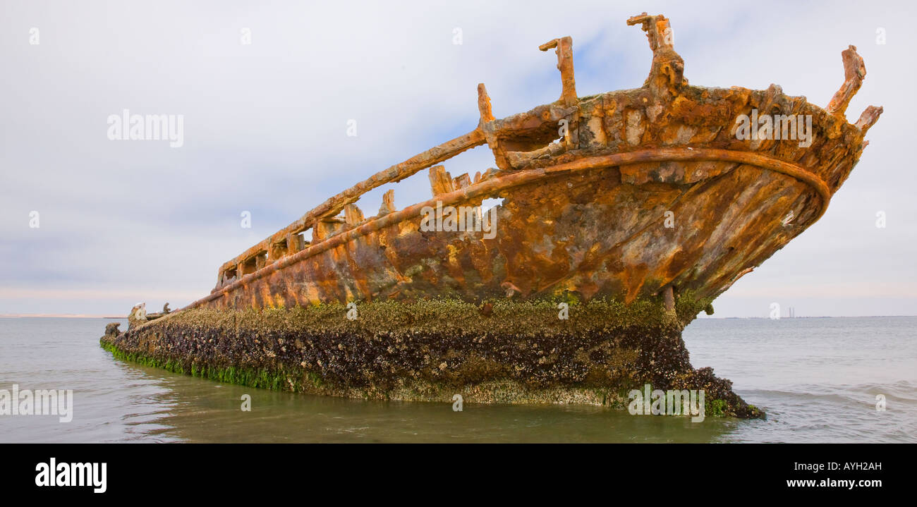 Old shipwreck sticking out of water, Namibia, Africa - Stock Image