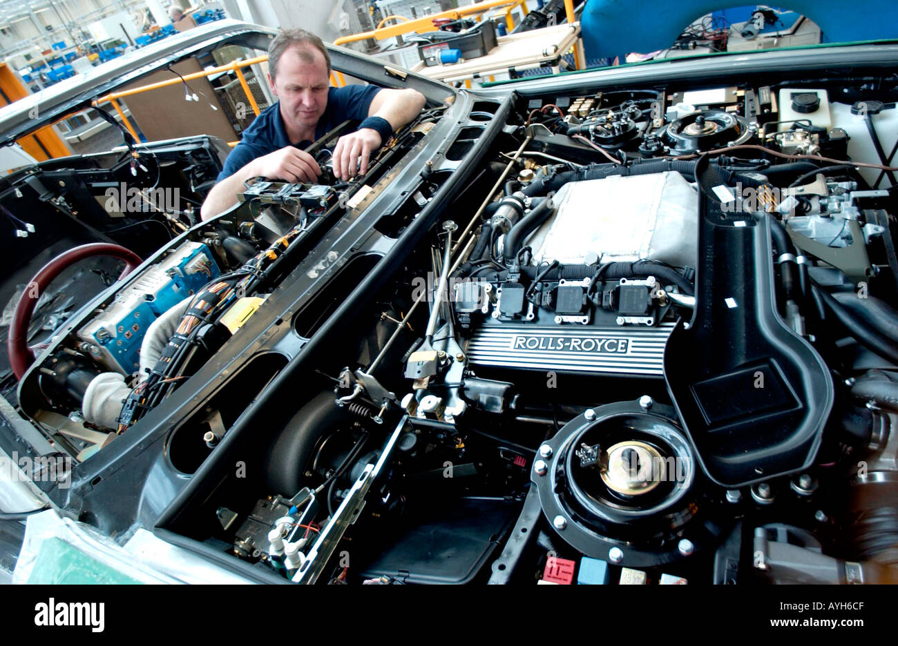 Rolls Royce worker on production line in Crewe - Stock Image