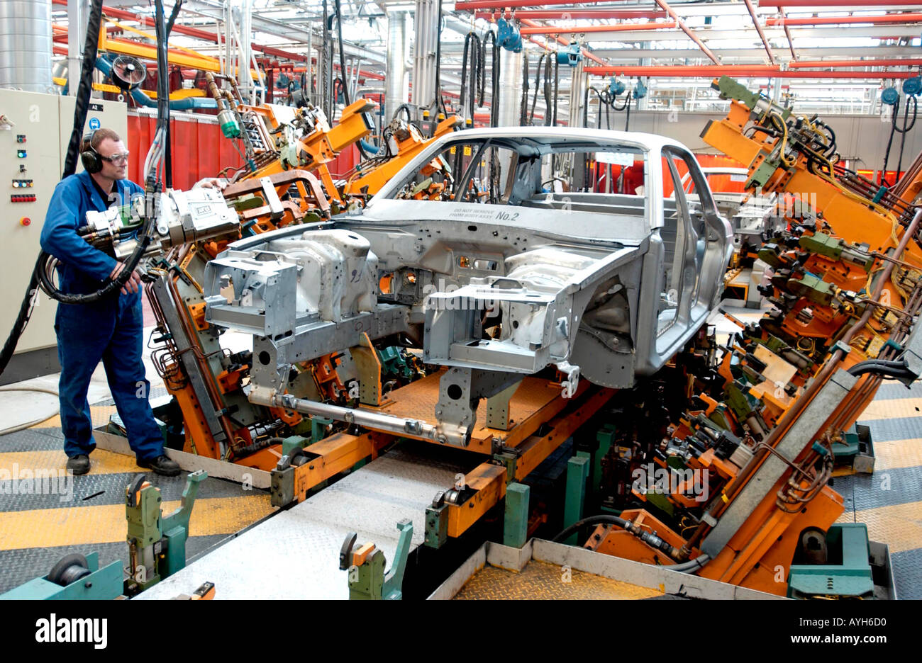 Rolls Royce Bentley production line at the company factory in Crewe, Cheshire. Picture shows welding body panels. - Stock Image