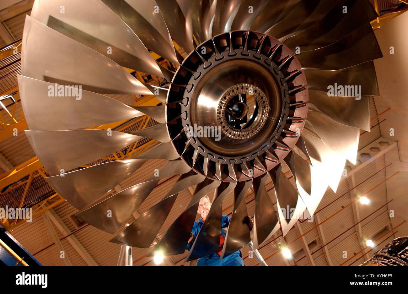 Rolls Royce New Engine Assembly and Testing Line Fitter inspects the Fan Case of a Trent 800 for a Boeing 777 - Stock Image