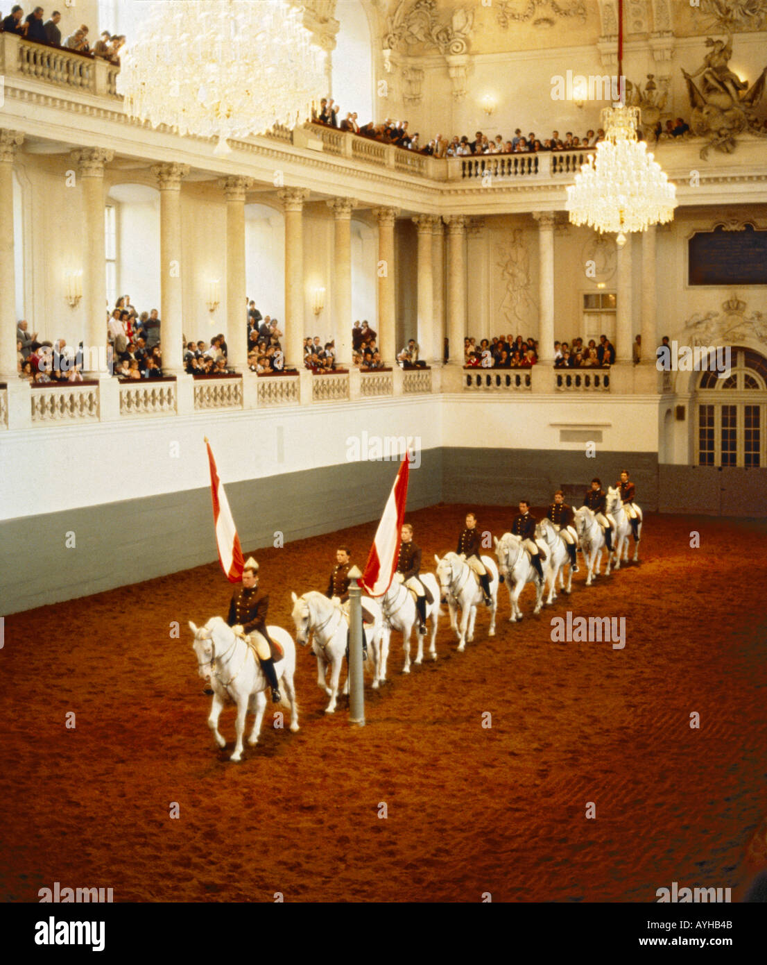 A straight line of riders and horses parade at The Spanish Riding School of Vienna Lipizzaner horse display Austria - Stock Image