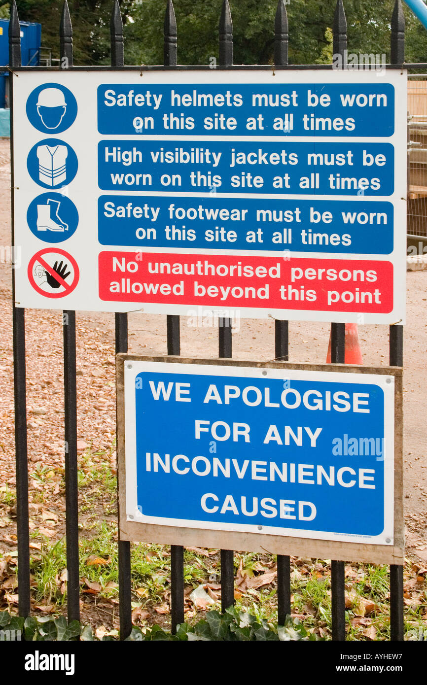 Mandatory health safety signs on a construction site fence Roath Park Cardiff UK - Stock Image