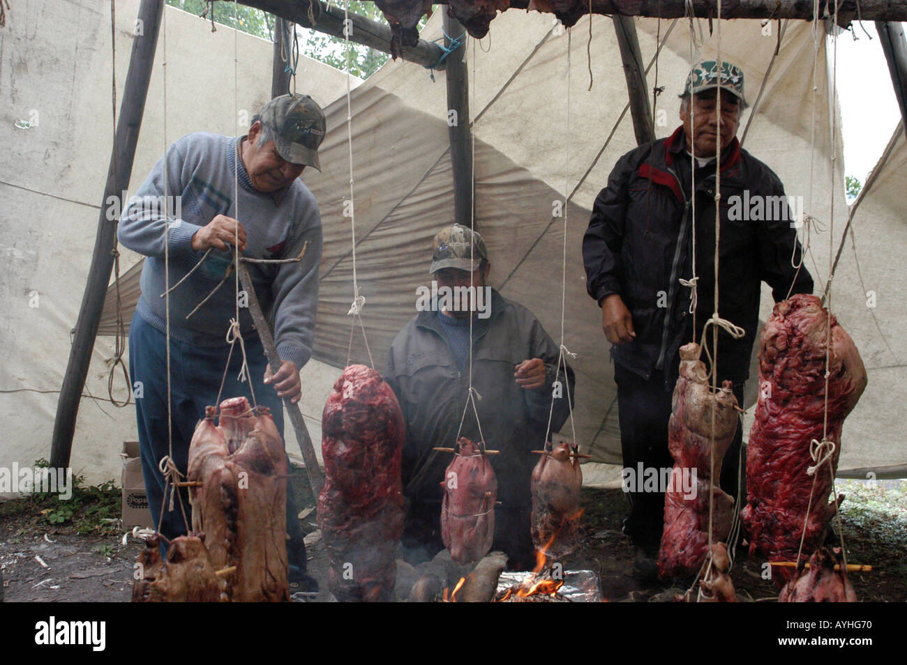Cree Native Men Cooking wild meat Mistissini Northern Quebec canada - Stock Image