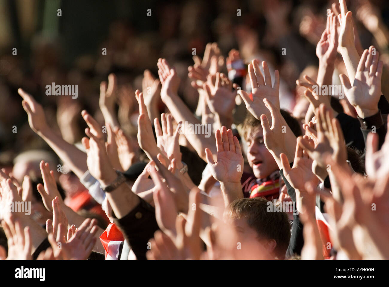 football fans wave their hands - Stock Image