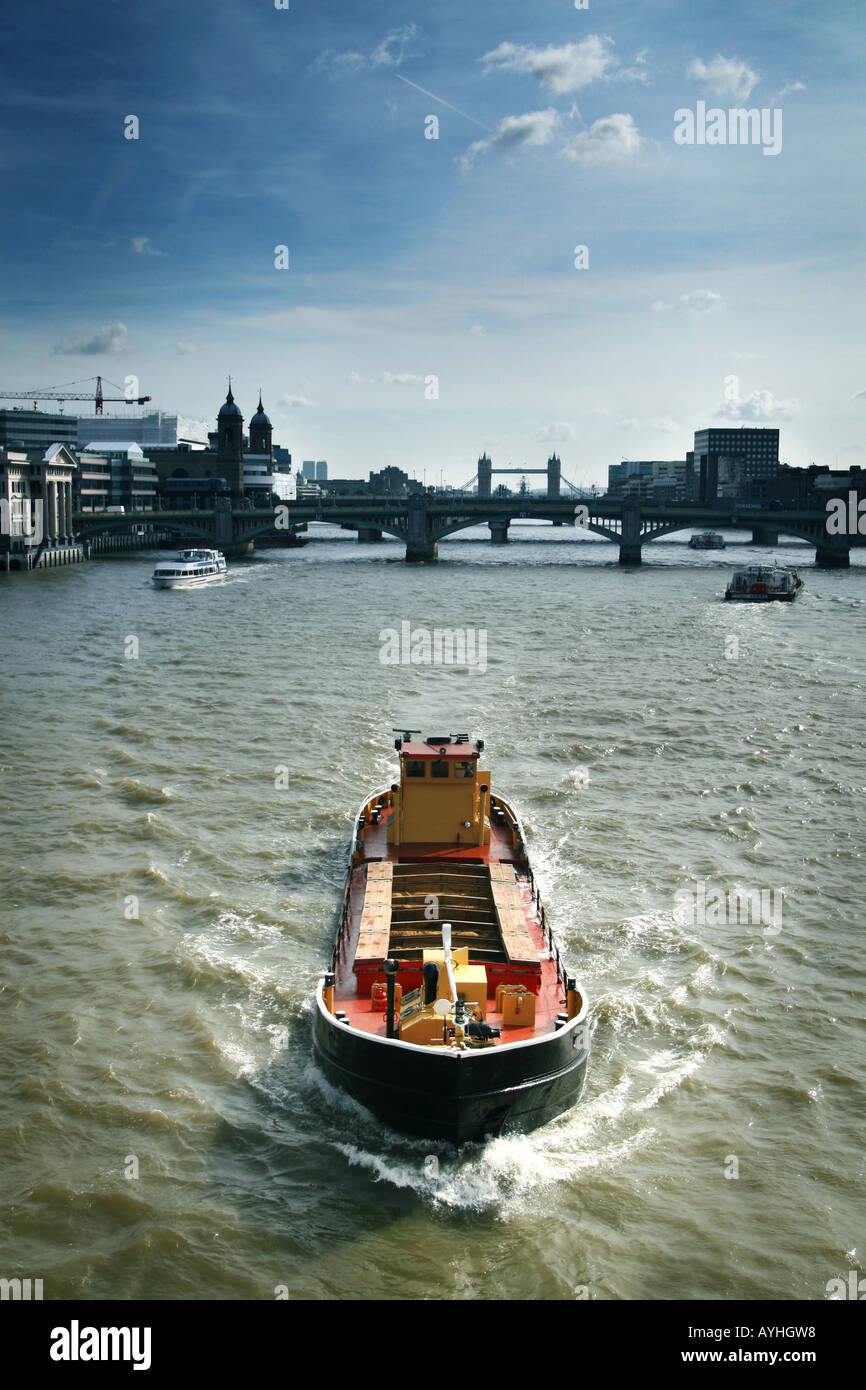 cargo barge on the river thames Stock Photo