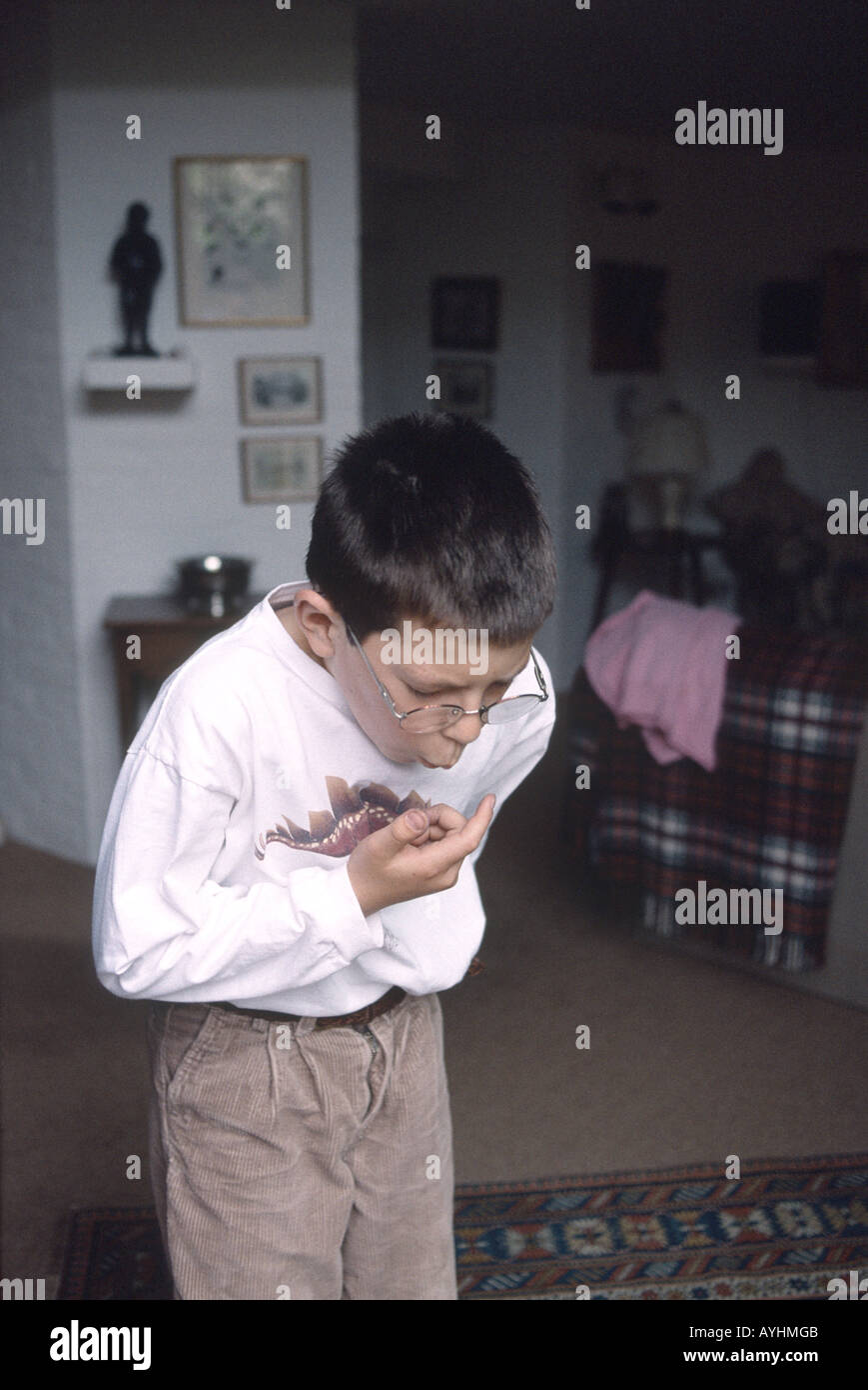 young boy choking  on a candy - Stock Image