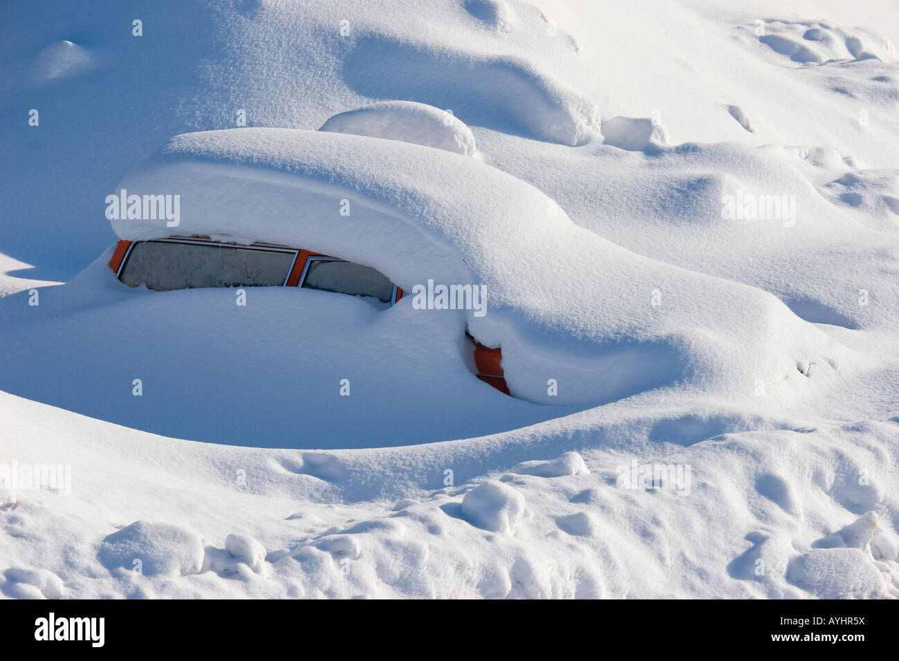A car is stuck in the snow - Stock Image