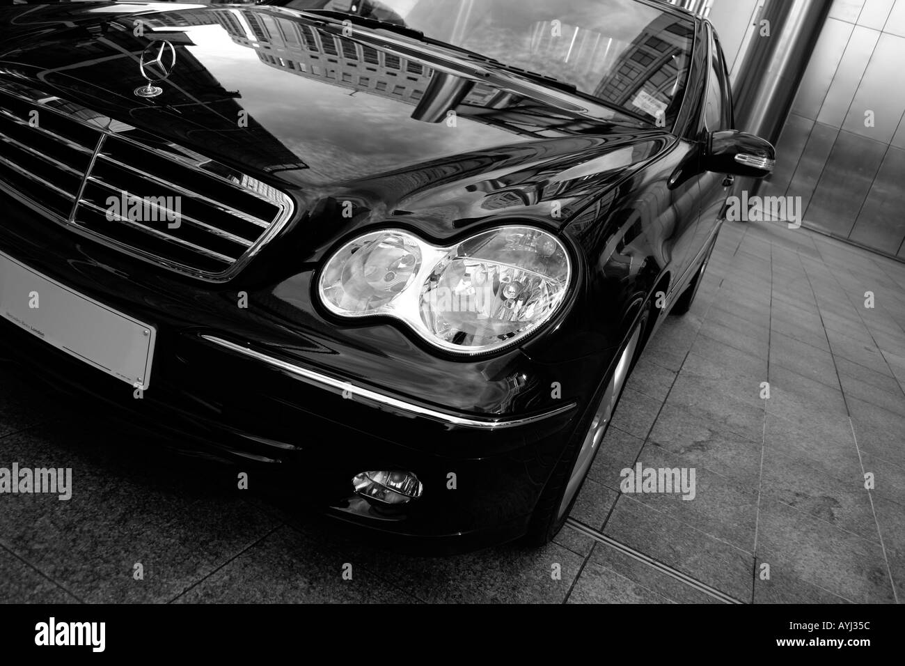 mercedes benz C Class Parked outside 1 Canada Square London - Stock Image