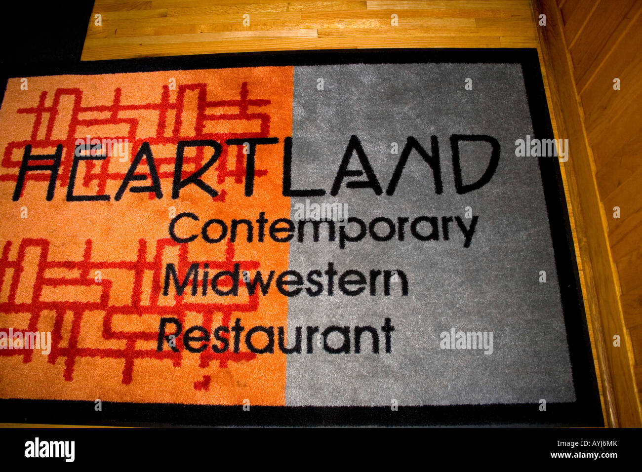 Floor mat at entrance to Heartland Contemporary Midwestern Restaurant. St Paul Minnesota USA Stock Photo