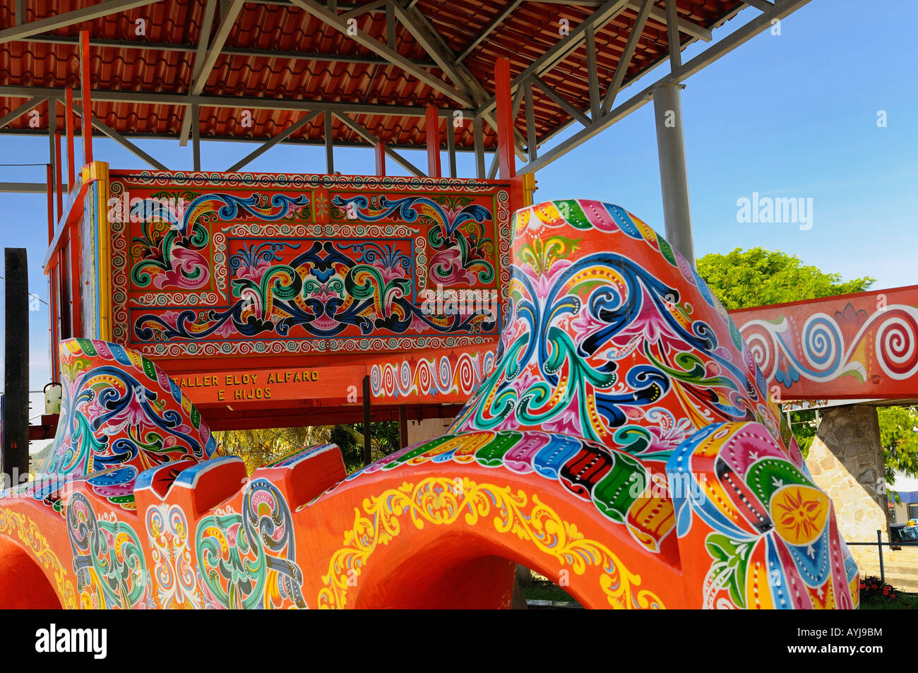 Bright colors of the worlds largest handcrafted painted Oxcart in Sarchi Costa Rica - Stock Image