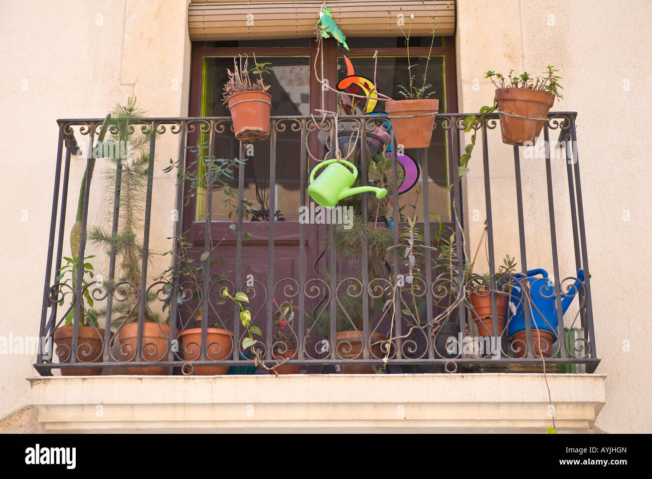 Balcony with pot plants and watering can old city Tarragona Spain Europe - Stock Image