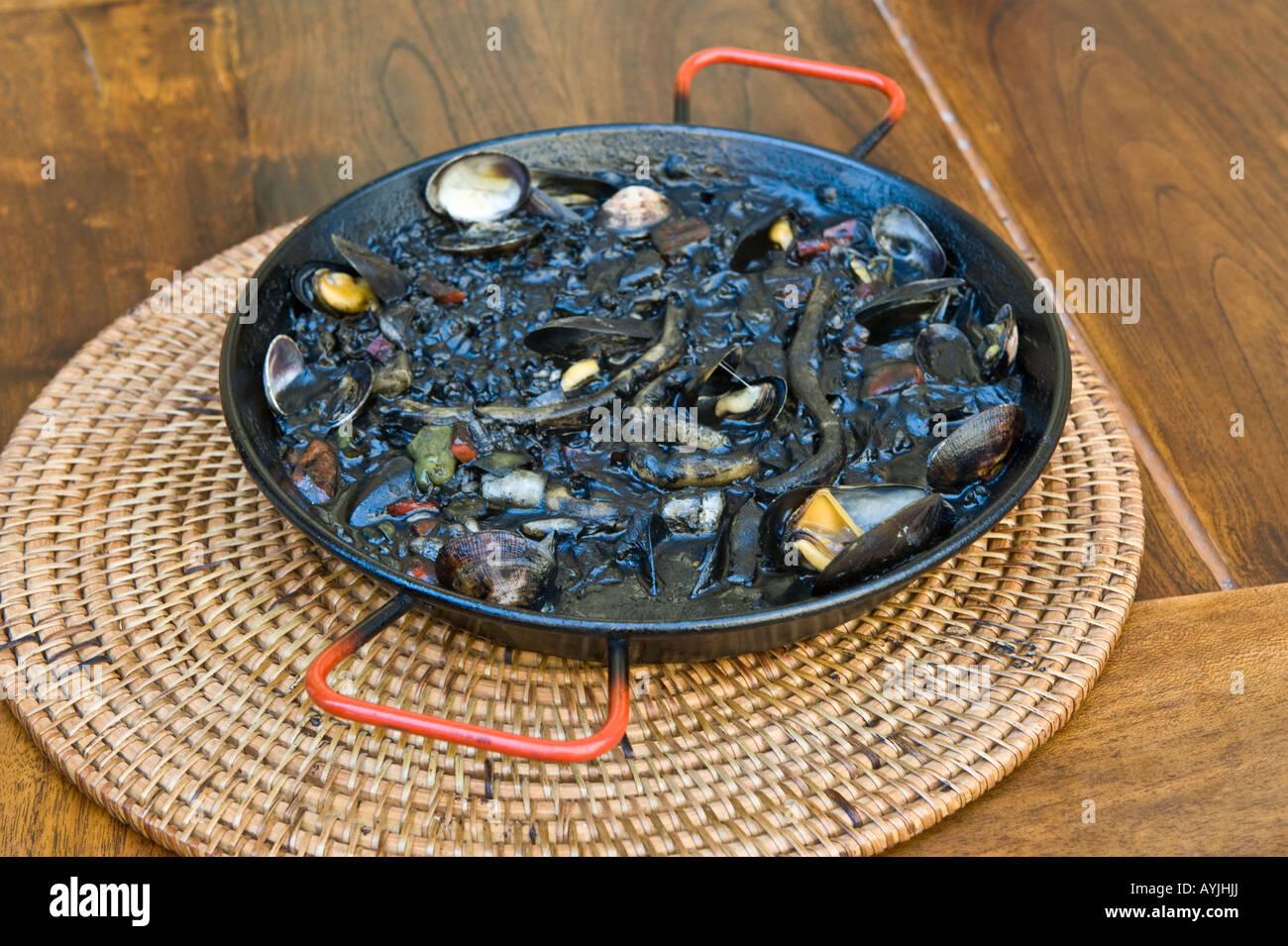 Arros Negre amb Sepietes Catalonian dish served on Pla de la Seu Tarragona Catalonia Spain - Stock Image