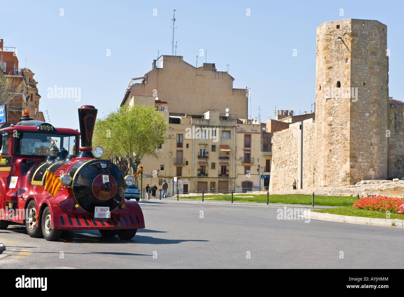 Pretori Roma and tourist train on Placa del Rei Tarragona Catalonia Spain - Stock Image