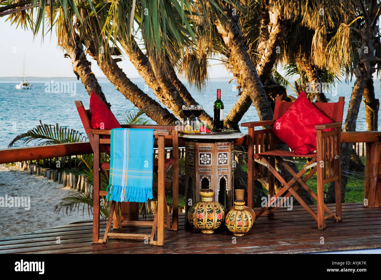Table with wine on pool deck of villa Exclusive luxury accommodation at Benguerra Lodge Mozambique Property released - Stock Image