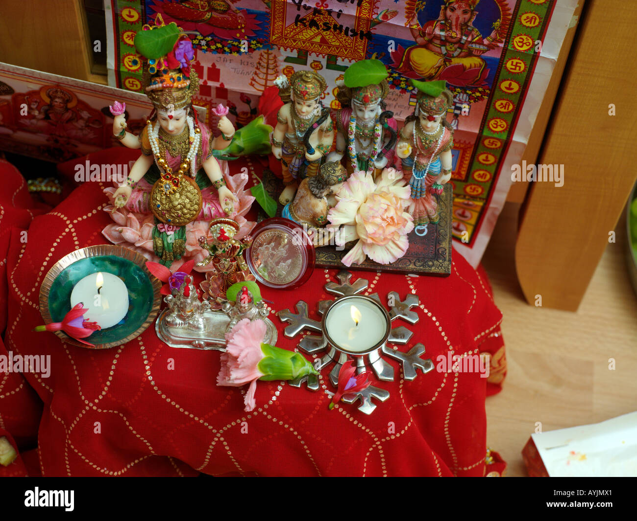 Diwali Decorations Gods Flowers and Candles Tooting London England - Stock Image