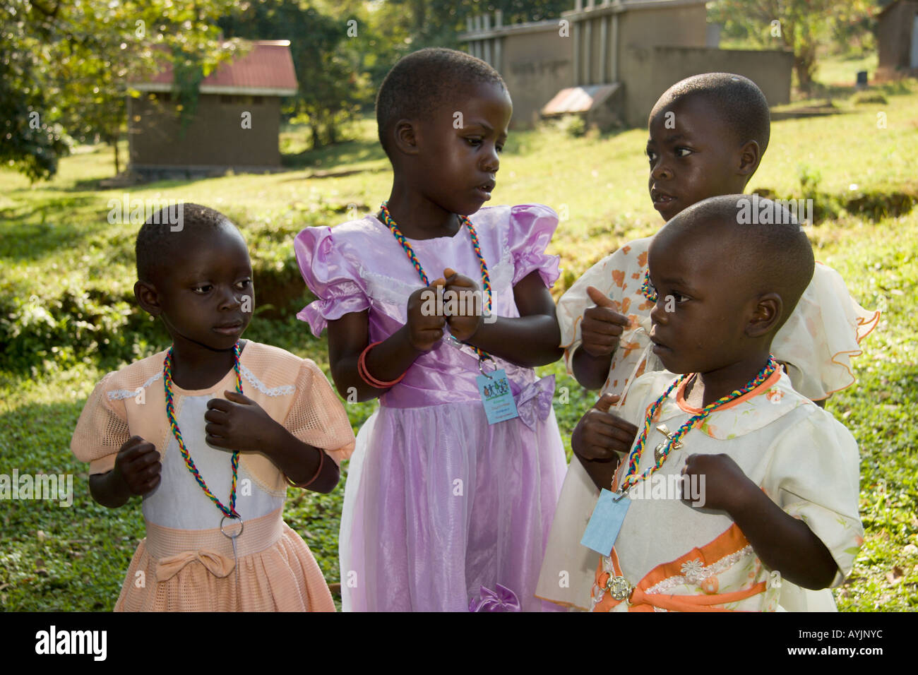 Children of fishing familes play while attending Mildmay HIV Aids clinic for screening treatment and education - Stock Image