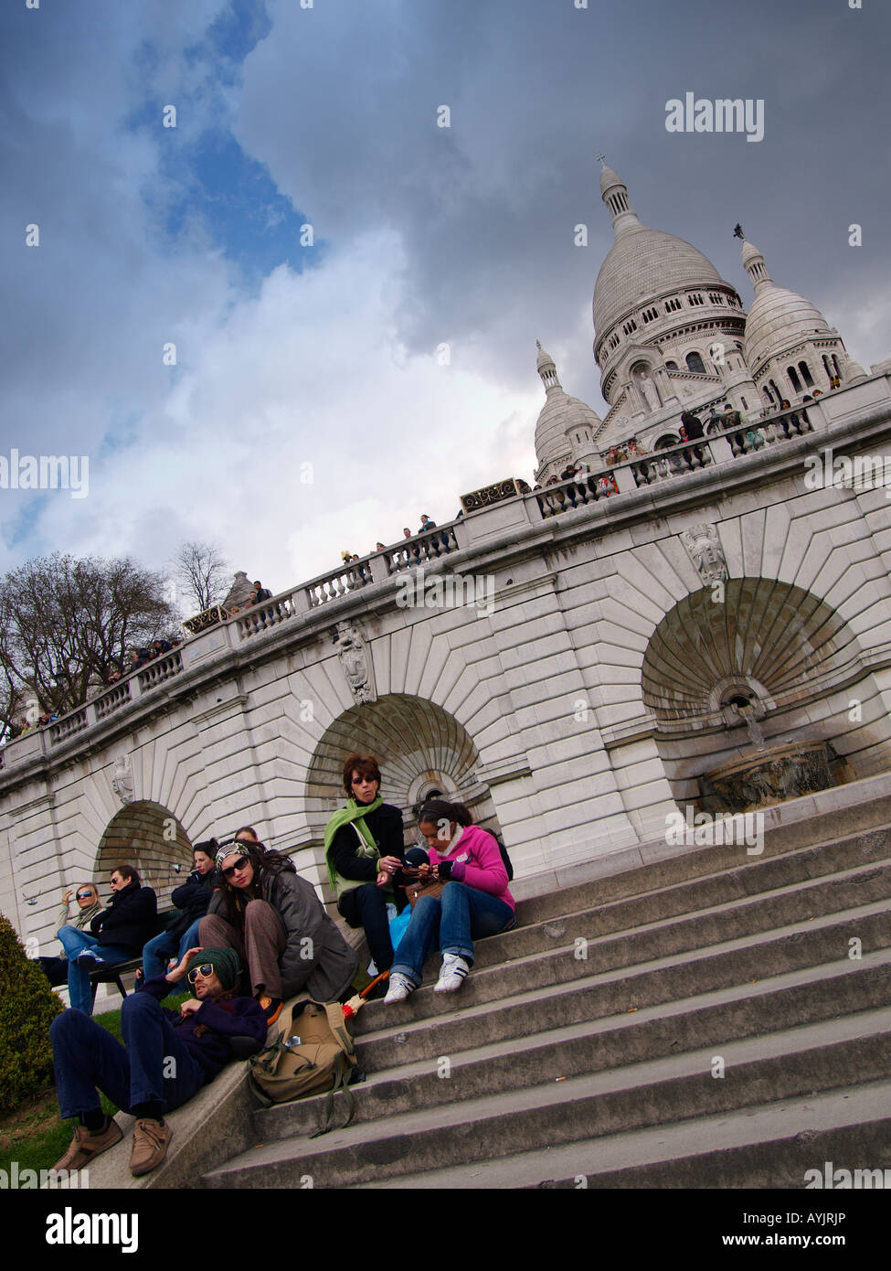 People on the steps of the famous Sacre Coeur church in Montmartre Paris France - Stock Image