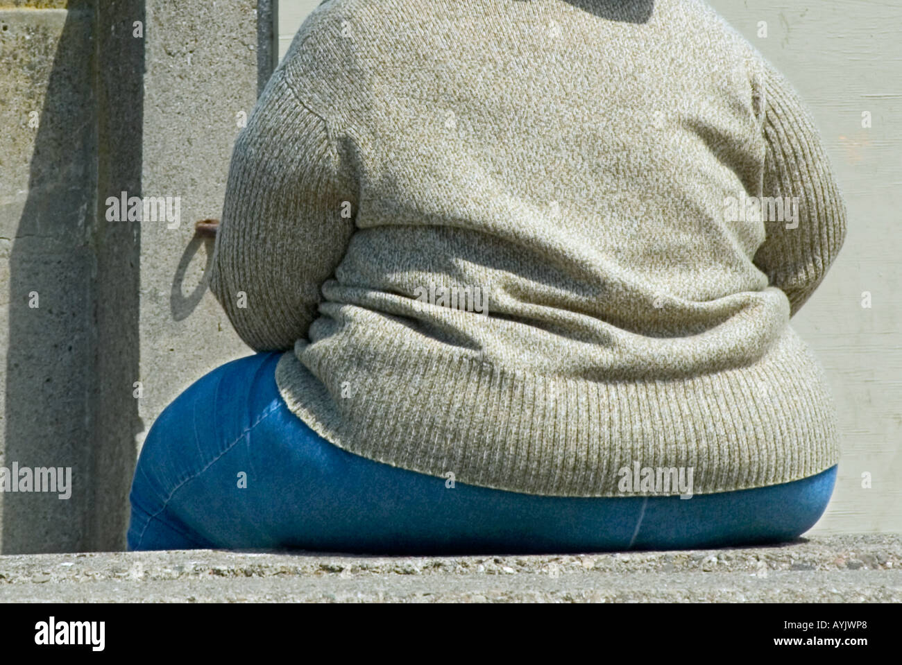 Close up of woman with a large butt illustrating results eating too much  junk food