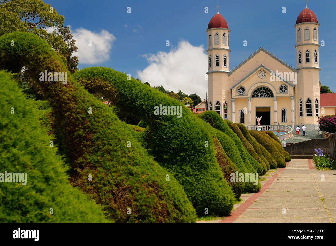 Topiary garden bushes and path in Zarcero Costa Rica leading to stairs and San Rafael catholic church - Stock Image