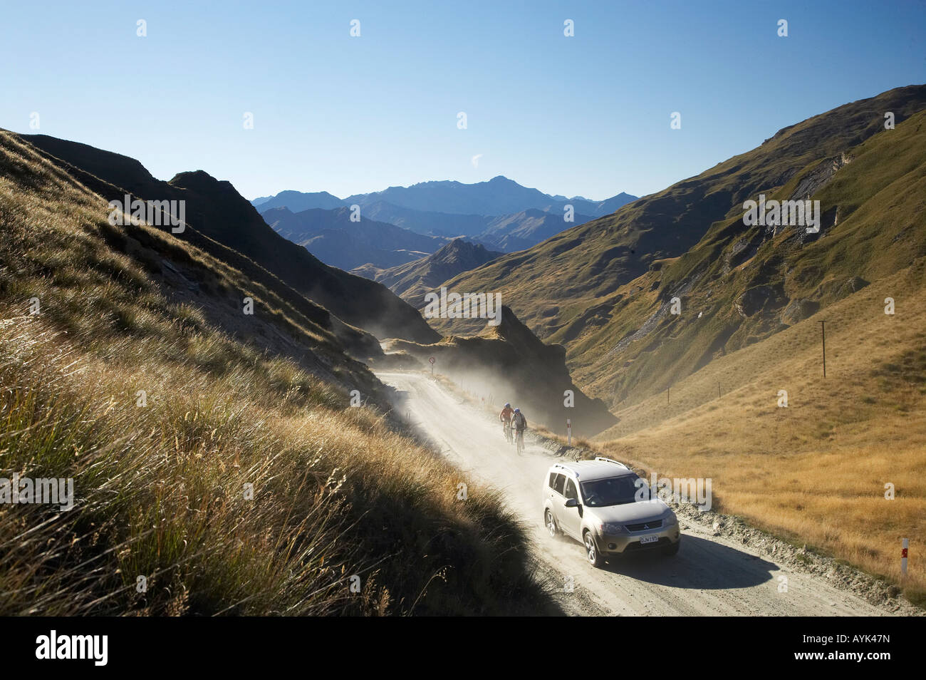 Four Wheel Drive and Mountain Bikers on Infamous Road into Skippers Canyon near Queenstown South Island New Zealand Stock Photo