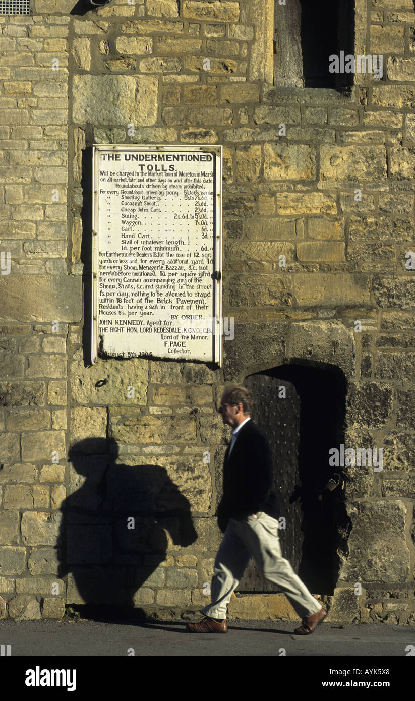 Doorway and toll notice on Curfew Tower, Moreton-in-Marsh, Gloucestershire, England, UK - Stock Image