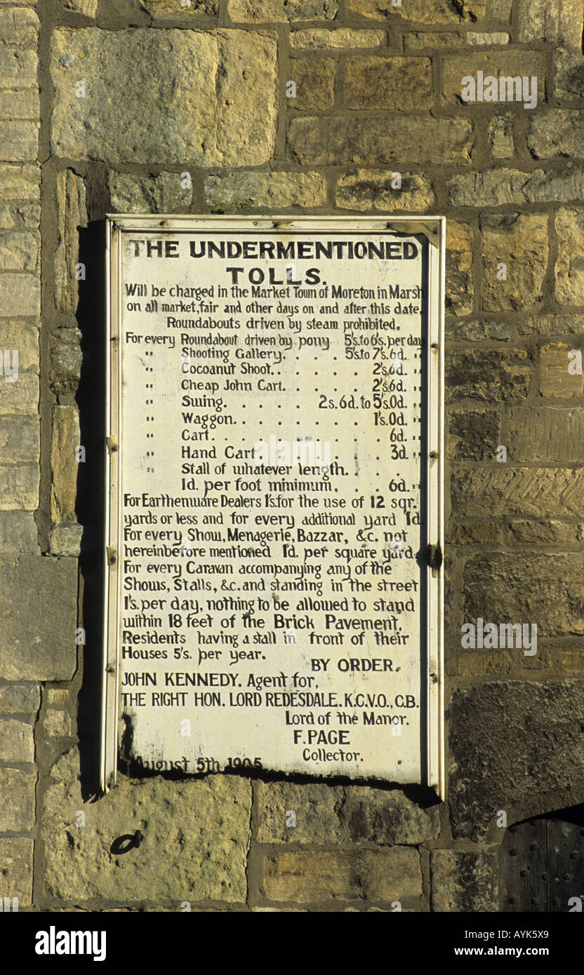 Toll notice on Curfew Tower, Moreton-in-Marsh, Gloucestershire, England, UK - Stock Image