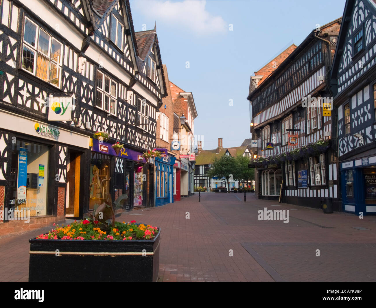 BLACK and WHITE TUDOR BUILDINGS 16th century timber-framed Crown Hotel in High Street Nantwich Cheshire England - Stock Image