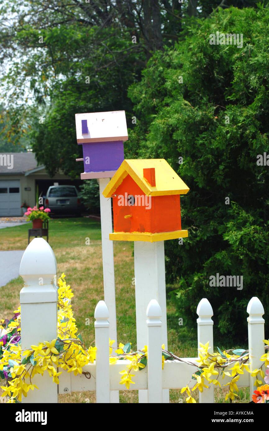 Multi-colored handmade birdhouses in a residential garden Stock ...