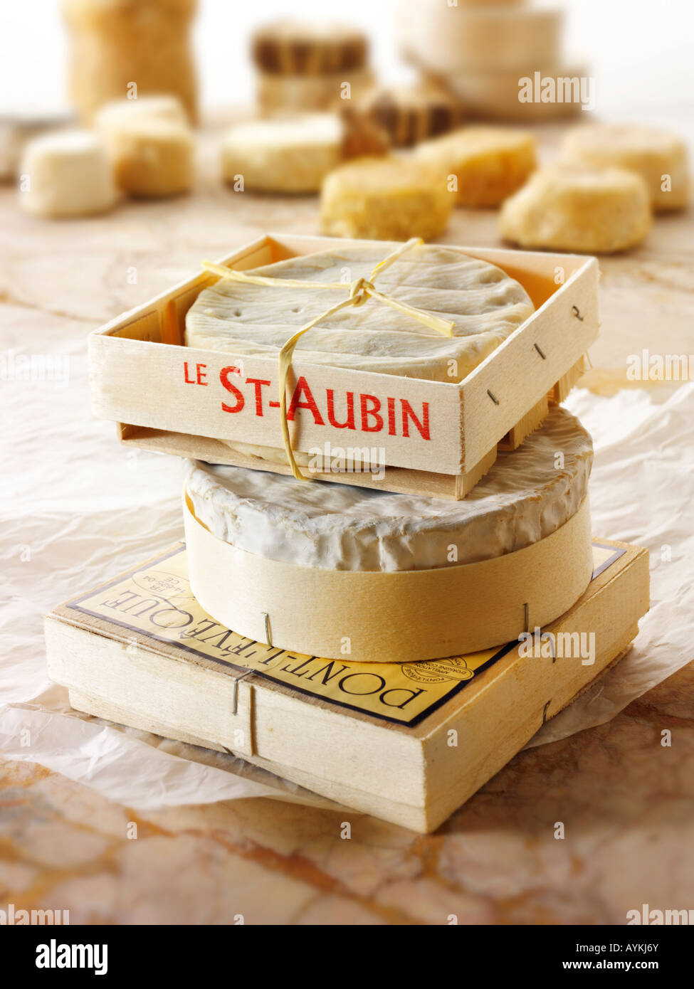 French Regional cheeses - From Top -   St Aubin, Camembert, and Pont L'eveque - Stock Image