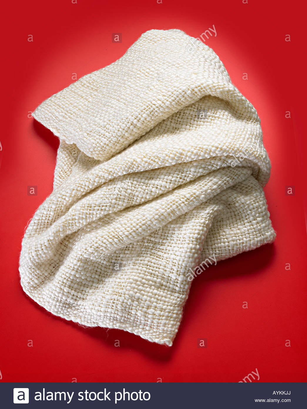 Natural unbleached fabric throw - Stock Image