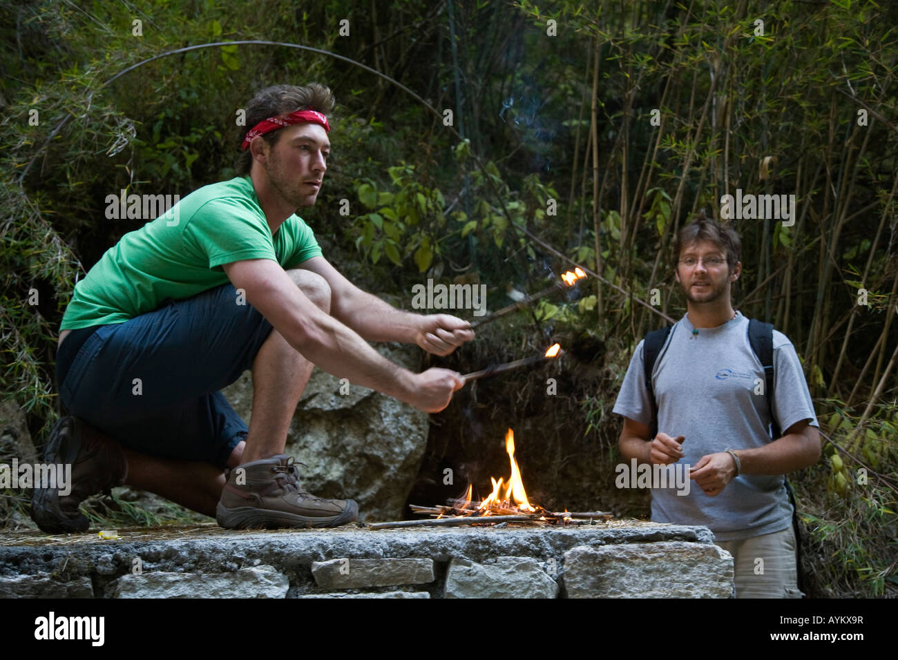 TREKKERS burn trash along the NAR PHU RIVER in the ANNAPURNA CONSERVATION AREA NEPAL HIMALAYA MR - Stock Image