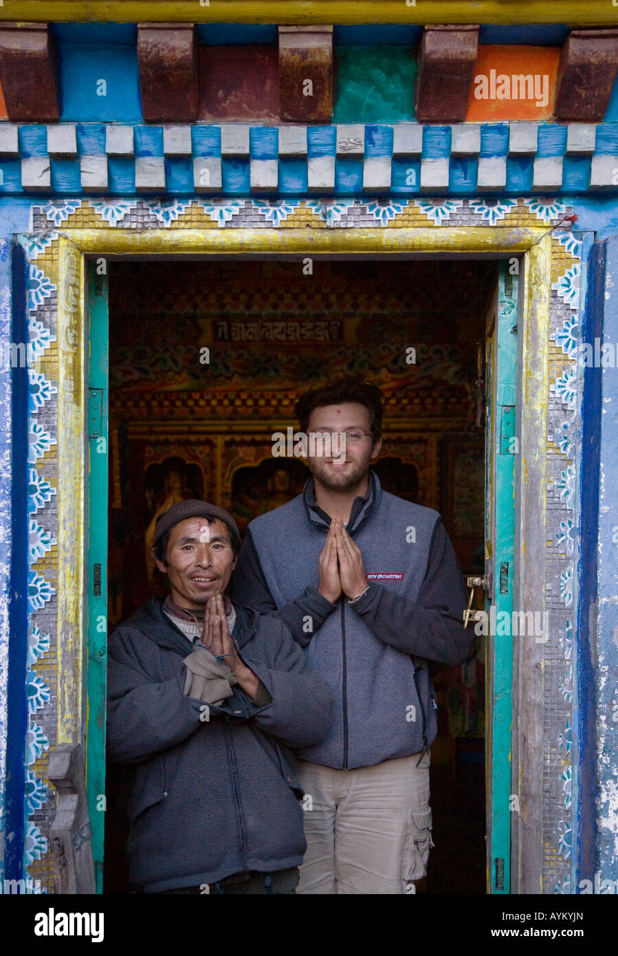 BODHI GARRETT and a devout BUDDHIST in the TIBETAN BUDDHIST TEMPLE in the village of KOTO on the ANNAPURNA CIRCUIT - Stock Image