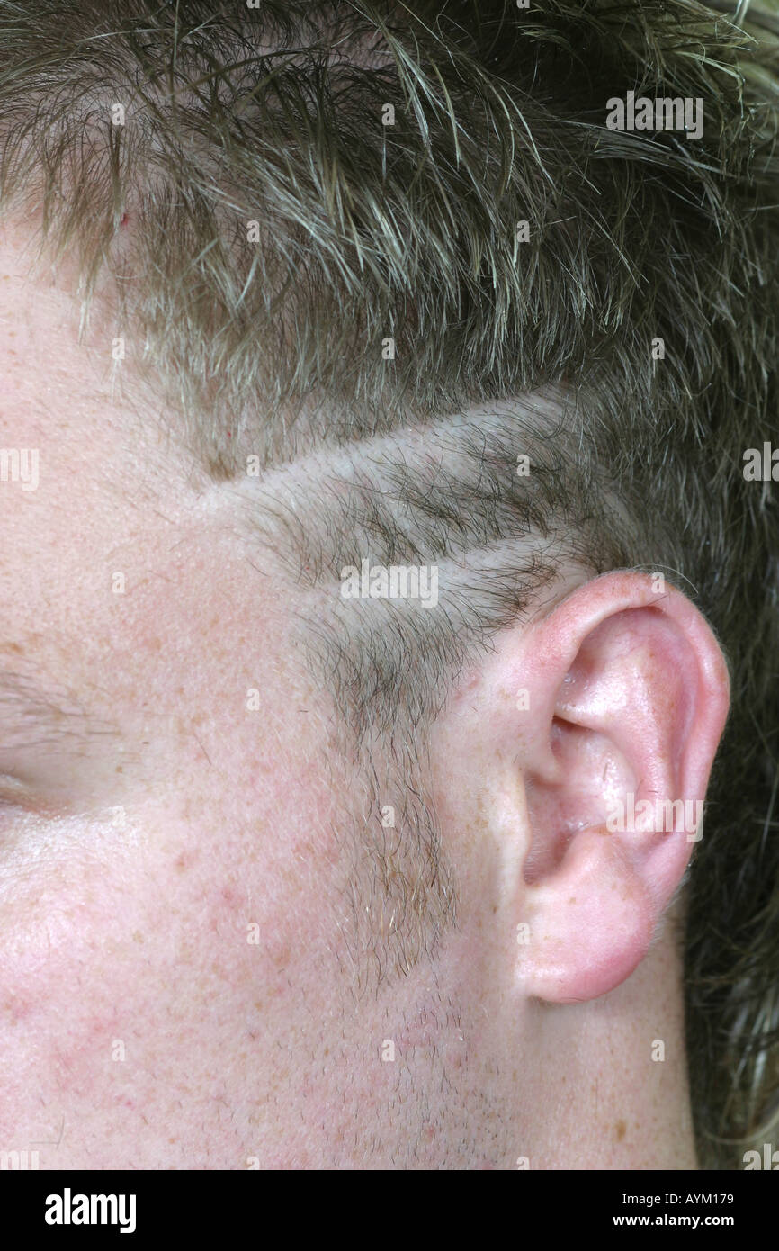 Modern Hair Style With Lines Shaved Above Ears Stock Photo 3178872