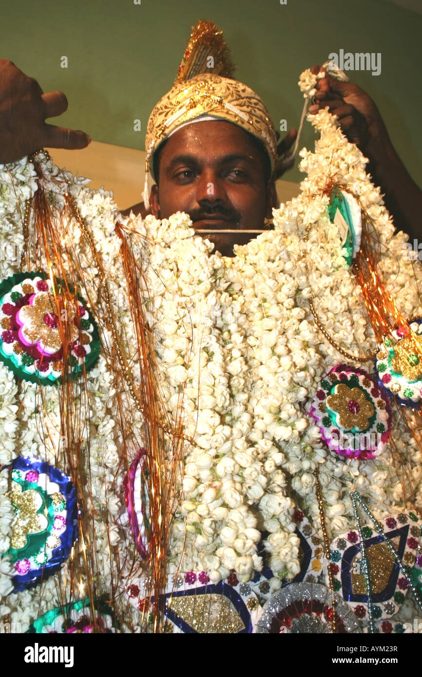 Muslim groom being dressed for his wedding , Tamil Nadu , India ...