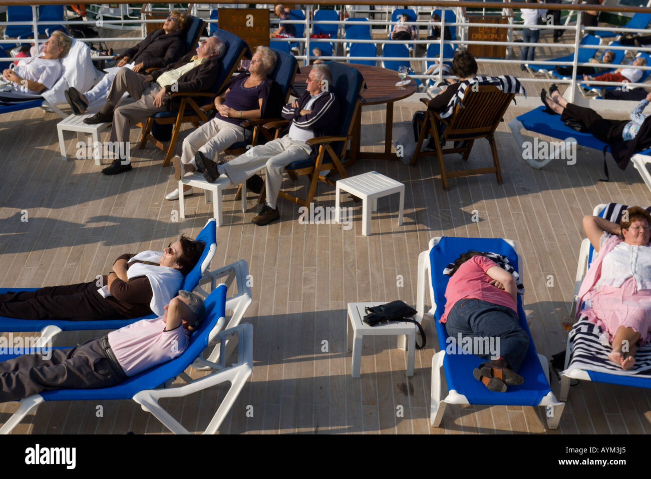 Passengers on board the QE2 for a short cruise - Stock Image