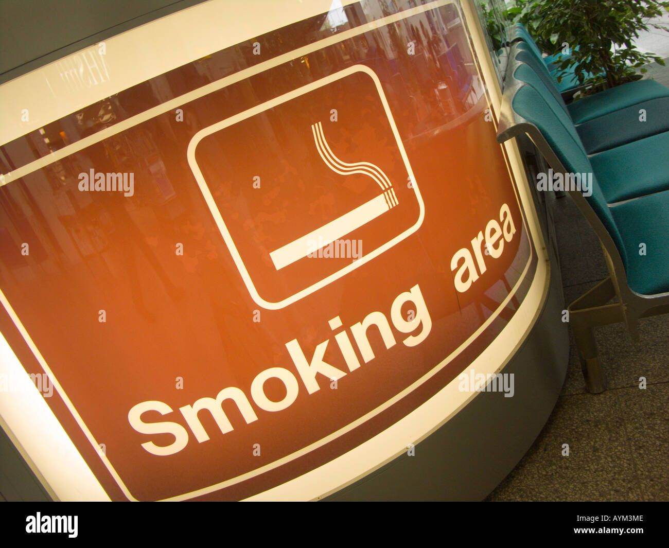 Indicating the smoking area at Southampton Airport with special ventilation and disposal features - before the indoor ban - Stock Image