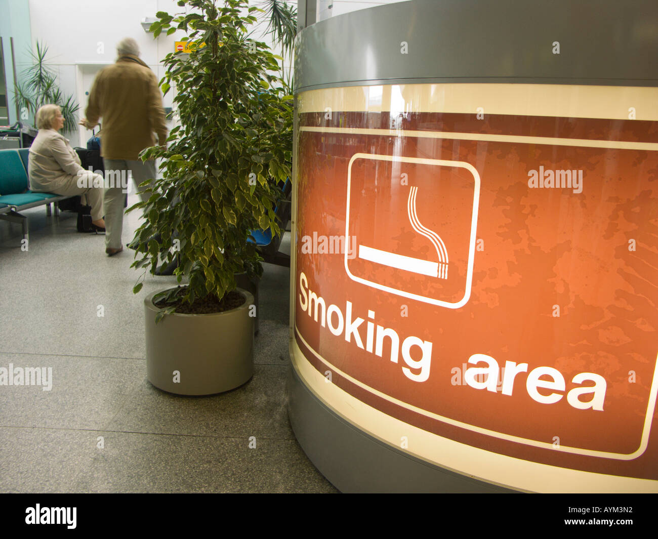 Indicating the smoking area at Southampton Airport with special ventilation and disposal features - before the smoking ban - Stock Image
