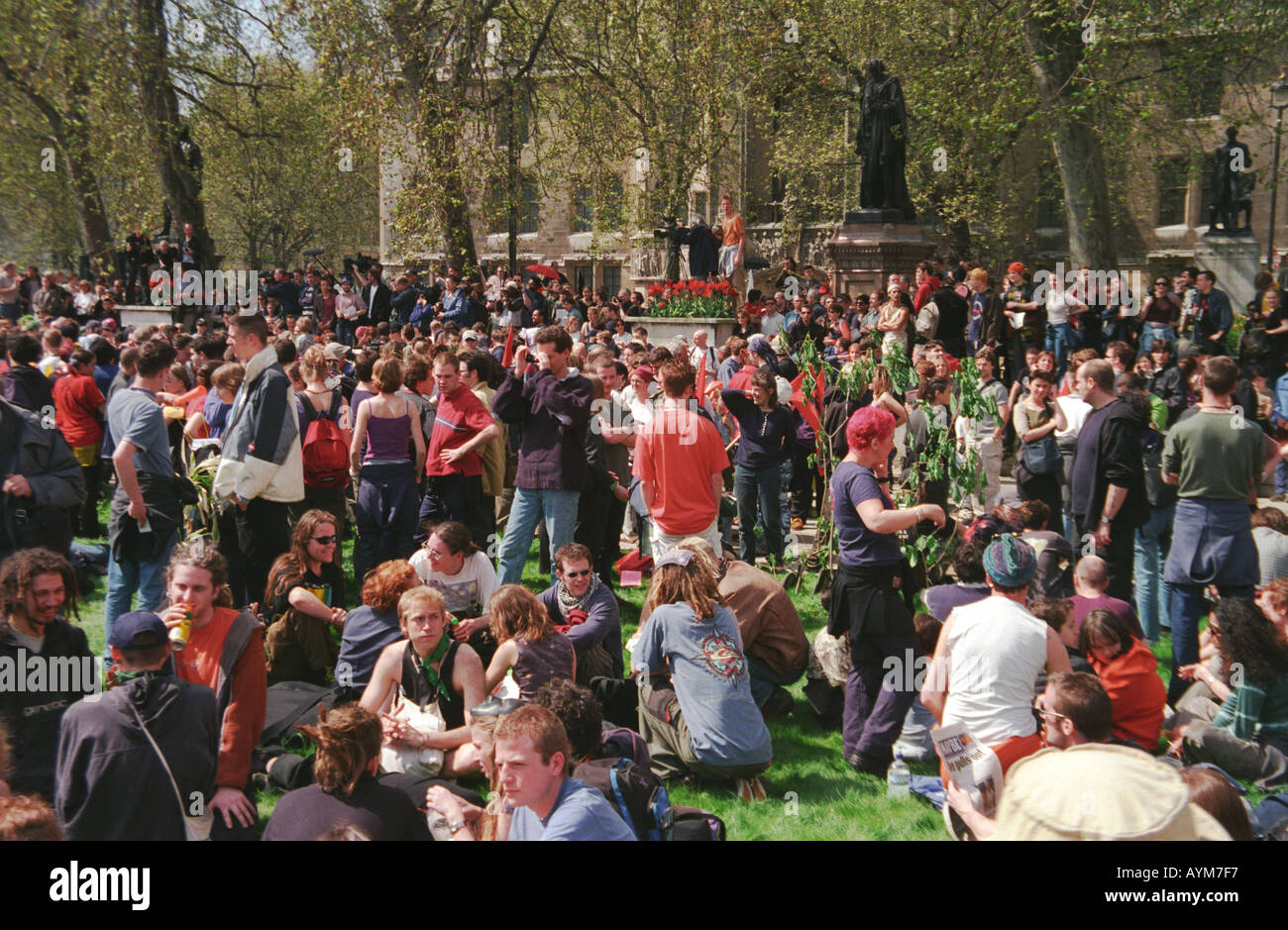 Young people in Parliament Square at the Anti capitalist protest on May Day 2000 in London - Stock Image